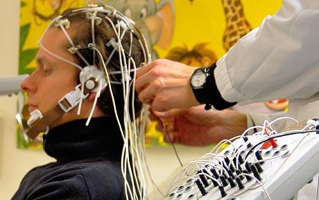 Measuring brain waves with EEG machine: Electric shock treatment 'cures memory loss', scientists claim